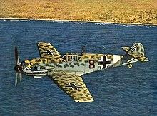 https://upload.wikimedia.org/wikipedia/commons/thumb/4/4d/Me_109E-4Trop_JG27_off_North_African_coast_1941.jpg/220px-Me_109E-4Trop_JG27_off_North_African_coast_1941.jpg