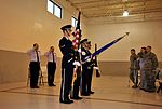 Members of the Civil Air Patrol and U.S. Air Force render a salute as honor guardsmen from Cannon Air Force Base, N.M., present the colors.jpg