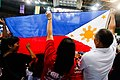 Members of the Filipino community in Brunei Darussalam are seen holding the Philippine Flag as a gesture of support for President Rodrigo Duterte at the indoor stadium of Hassanal Bolkiah National Sports Complex.jpg