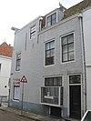 foto van Apart genummerde zij-ingang in achterbouw van het pand Molstraat 23