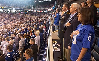 Vice President Mike Pence, Second Lady Karen Pence, and Major General Courtney P. Carr stand for the National Anthem. Mike Pence NFL Protests 2017.jpg