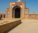 Brick enclosure of Mirza Baqi Baig Uzbak's tomb, south of the tomb of Nawab Isa Khan the Younger