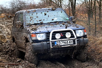 Off-road racing - A Mitsubishi Pajero racing in mud in Bulgaria