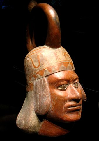 A Moche ceramic vessel from the 5th century depicting a man's head. Moche portrait ceramic Quai Branly 71.1930.19.162 n2.jpg