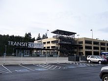 A parking garage and bus shelter