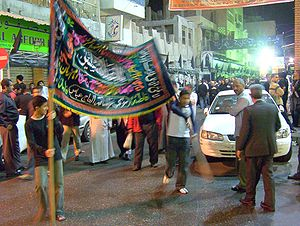A banner (aalam) being carried in a procession...