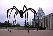 Maman stands outside the building's main entrance