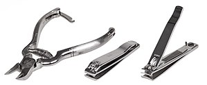 Nail clipper - A variety of nail clippers; the clipper on the left is in the plier style; the centre and right clippers are in the compound lever style