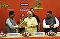 Narendra Modi being presented a memento at the inauguration of the 'Urja Sangam', a summit dedicated to energy, in New Delhi. The Union Minister for Communications & Information Technology.jpg