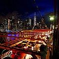 New York City bridge and skyline at night.jpg