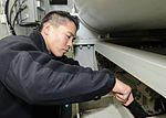 Nimitz Sailor performs arresting gear maintenance 151123-N-UM507-030.jpg