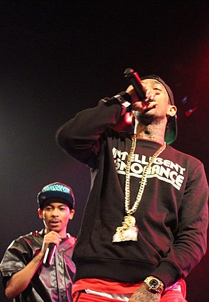 Nipsey Hussle - Hussle (front) performing with singer TeeFlii in December 2013.