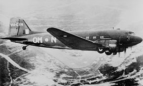 Side view of twin-engined military place in flight