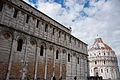 Northern face of the Camposanto (-Holy Field-) (forefront), The Baptistry of St. John (background), Piazza dei Miracoli (-Square of Miracles-). Pisa, Tuscany, Central Italy.jpg