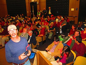 Occupy movement in the United States - Occupy Charlottesville packs Charlottesville City Council chambers in what Councilor David Brown says is the best-attended meeting in his 8 years serving. Supporters wear red and almost 60 people ask the council to allow the encampment. A handful of those who speak on the issue ask for the council to start enforcing the 11 p.m. curfew in Lee Park.