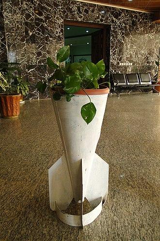 Halabja chemical attack - An original bomb casing used as flower pot at the Halabja Memorial Monument in 2011