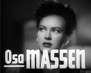 Cropped screenshot of Osa Massen from the trai...