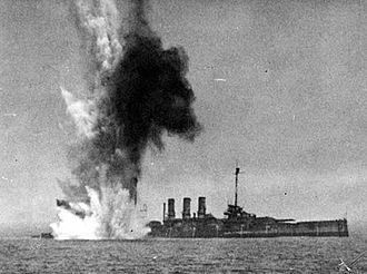 """20th Bomb Squadron - A 2,000 lb. bomb """"near-miss"""" severely damages Ostfriesland at the stern hull plates"""