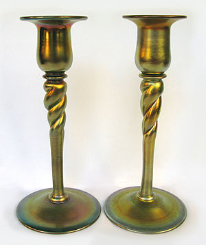Steuben Glass Works - These are a pair of handblown Steuben gold Aurene glass candlesticks designed by Frederick Carder for the Steuben Glass Works, ca. 1913. (From a private collection)
