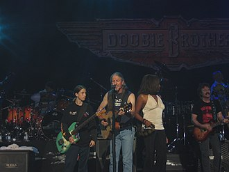 Patrick Simmons - Simmons performing with the Doobie Brothers in November 2004.  His son Patrick Jr. is on his right.