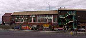 Perry Barr Stadium - Stadium from Aldridge Road. There are extensions to either side of the original block.
