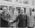 Photograph of President Truman shaking hands with Secretary of State James F. Byrnes after awarding him the... - NARA - 199180.tif