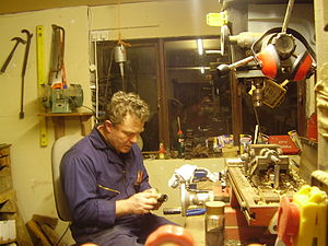 Marcus Hernon - Marcus Hernon mending a flute in his workshop