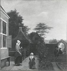 Woman with a glass of wine and a child in a garden