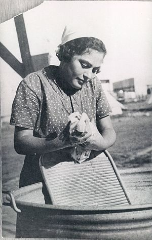 Washboard (laundry) - Woman on an Israeli Kibbutz using a washboard to do laundry