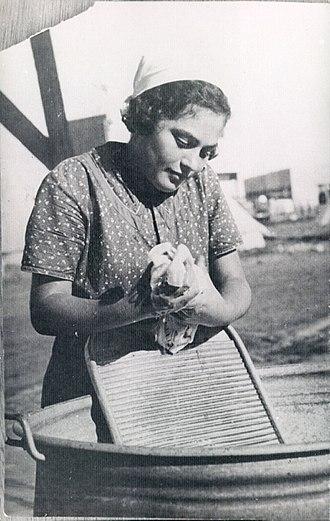 Washboard (laundry) - Woman on an Israeli Kibbutz using a washboard to do laundry