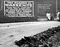 Pile of discarded Warrenite composition material near a Warrenite sign, Washington, May 8, 1912 (INDOCC 513).jpg