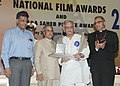 Pranab Mukherjee presenting the Dadasaheb Phalke Award 2013 to Shri Gulzar, the veteran film lyricist, director, screen writer, producer and poet, at the 61st National Film Awards Function.jpg