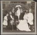 Pres. and Mrs. Theodore Roosevelt seated on lawn, surrounded by their family LCCN95504424.tif