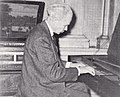 Professor Bruce Simonds playing the 1784 Christian Gotthelf Hoffman clavichord (Clav. No. 10) in Wistariahurst, Holyoke, Massachusetts, 1955.jpg