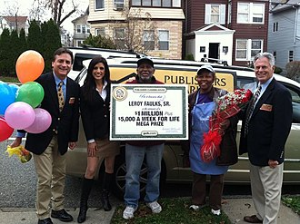 Publishers Clearing House - The Prize Patrol delivering an oversized check to a sweepstakes winner for $1 million plus $5,000 a week for life