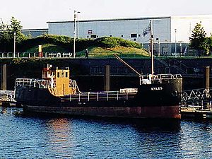 "Braehead - MV Kyles, a diesel powered ""Clyde puffer"", on the River Clyde at Braehead shopping centre."