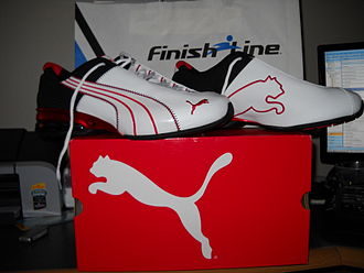 "Puma (brand) - A pair of PUMA sport-lifestyle shoes with the company's distinctive ""Formstrip"" design"
