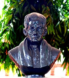 Stone bust of R. Murmu in the Odisha Tribal Development Society (OTDS), Bhubaneswar office.