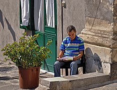 Reading a newspaper. Catania, Italy.jpg