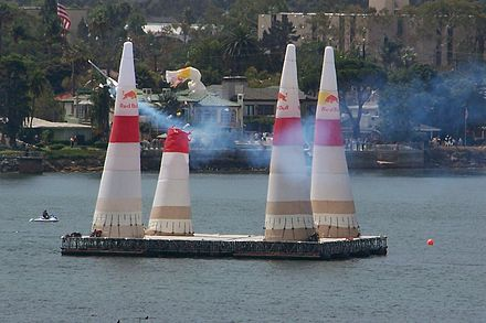 A plane slices through a pylon, resulting in a penalty RedBullAirRaceHit.jpg