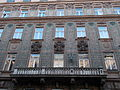 Residential building with balcony and stone heads. Detail. Monument ID 8237 - Budapest District XI., Budafoki Rd 3-5.JPG