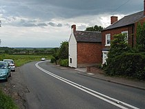 Road, fields and cottages, Hanbury.jpg
