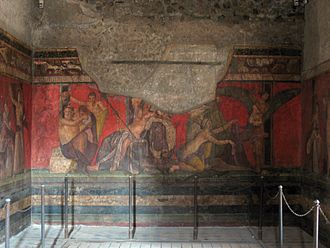Conservation issues of Pompeii and Herculaneum - This fresco of a girl's initiation into the cult of Dionysos shows not only damage before and during the eruption, but also a distinct fade in the lustre of the paint caused from exposure after excavation. Flash photography is prohibited to inhibit further deterioration.