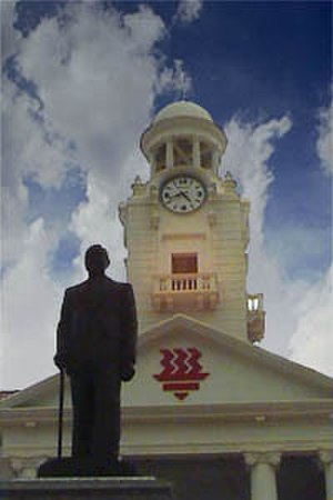 The Chinese High School Clock Tower Building - Hwa Chong Institution Clock Tower Building with a statue of the school's founder, Tan Kah Kee, in the foreground