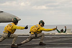 Sailors abroad the USS Dwight D. Eisenhower perform flight operations as Secretary of Defense Ash Carter and Defence Minister Manohar Parrikar tour the aircraft carrier.jpg