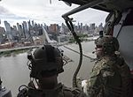 Sailors fly past the New York City skyline on a MH-60S Sea Hawk helicopter as part of Fleet Week New York 2017. (34148334304).jpg