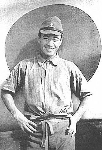 Saburō Sakai - Sakai posing in front of the hinomaru on his Mitsubishi A5M  Type 96 fighter (Wuhan, 1939).