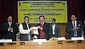 Santosh Kumar Gangwar releasing a book titled 'Mulberry Sericulture' at the foundation stone laying ceremony of the Apparel and Garment Manufacturing Centre in Sikkim, at Gangtok. The Chief Minister of Sikkim.jpg