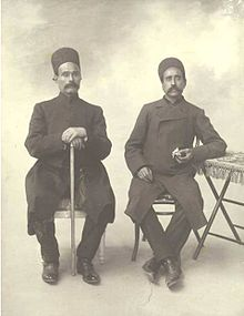 Two seated men