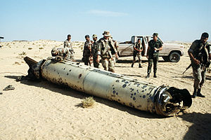 English: Military personnel examine a Scud mis...